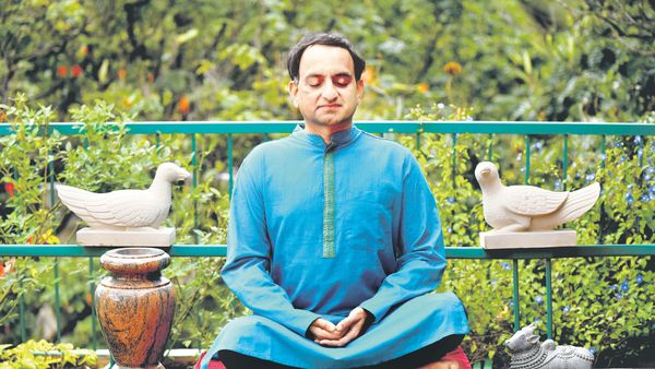 Siddharth Mangharam Practicing Vipassana Meditation In His Balcony